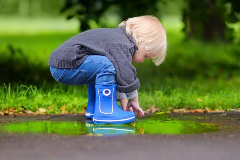 child playing in septic system leak