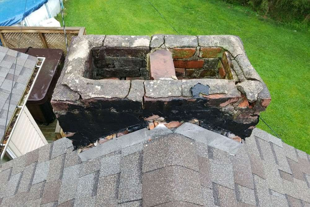 real estate chimney signs of spalling bricks, cracked caps, missing rain hats damage