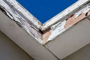 Peeling paint and rotted wood is definitely a sign of severe rainwater runoff damage